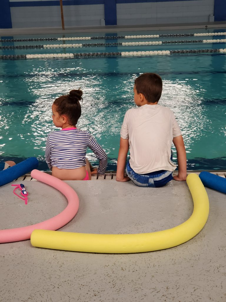 swim lessons, learning how to safely jump in the pool