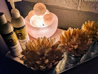 Calming lotion, lights, and flowers from our massage room