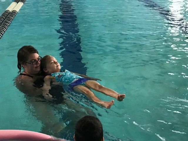 Swim lessons, working on back float
